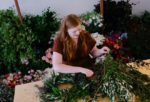 Florist arranges bunch of Australian natives