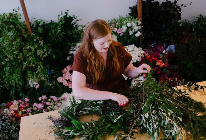 Florist arranges bunch of Australian natives